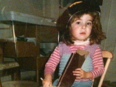 2-13-15-Young Alisa playing a cereal box cello
